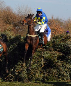 Auroras Encore jumps the Open Ditch in the English Grand National at Aintree.