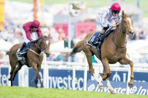 Jockey Richard Hughes rides Talent to victory in The Oaks at the Epsom Derby Festival.